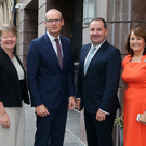 Simon Coveney TD (second from left) with (left) NI Chamber President Ellvena Graham, Chief Executive Ann McGregor and Paul Murnaghan, BT Business NI, in Belfast. Photo: Kelvin Boyes