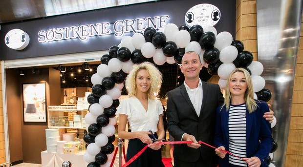 From left, blogger Niamh Cunningham helps joint venture partners Richard and Norma Power open their latest NI store