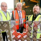 KME Steelworks directors Seamus Murchan (left) and Jason Quinn with Alderman Allan Ewart, chairman of Lisburn and Castlereagh City Council's development committee, and (right) the Wear Crossing in Sunderland