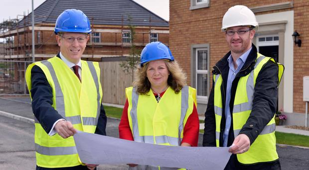 Co-ownership Housing chief executive Mark Graham (left) with customer services director Glynis Hobson and Tim McCauley of Windsor Developments at Hadlow in Donaghadee, which is set to become a co-ownership development