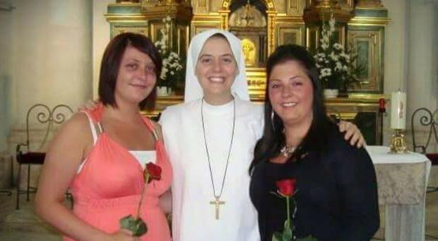 Sister Clare Crockett with her sisters Megan (left) and Shauna