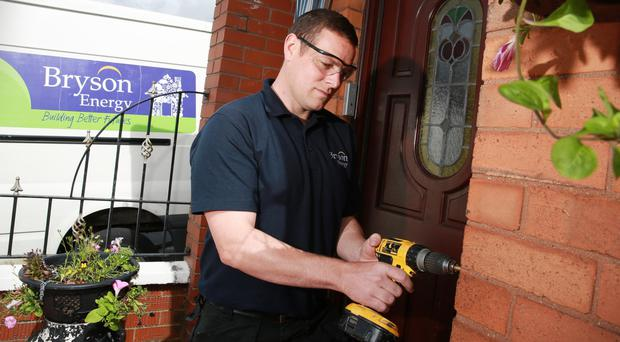 Vincent Quinn from Bryson Energy carries out repairs at a home in Belfast
