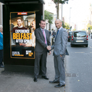 Peter Megarrell (right), Clear Channel NI, with Tristan Aiken of Translink in front of one of the digital screens at a Translink bus shelter