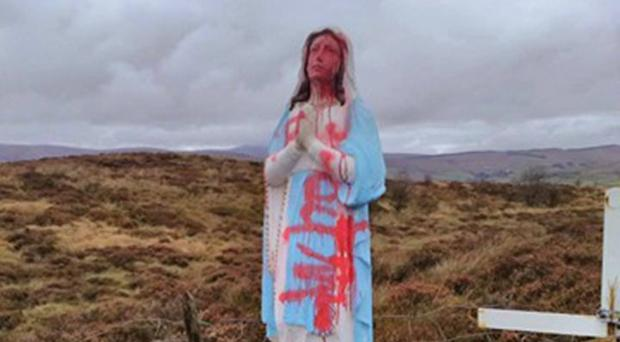 The statue which has been daubed with graffiti