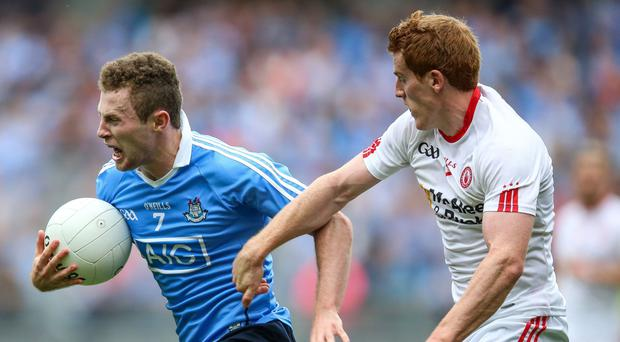 Dublin's Jack McCaffrey and Peter Harte of Tyrone (right), both wearing O'Neills kits