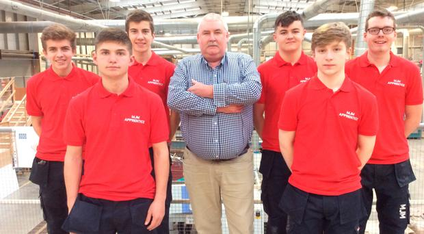 Back row, from left: apprentices Niall Casey, Scott Dale, MJM Group apprentice programme manager John Fisher, Brendan Devlin and Philip Newell. Front row, from left: Marco Gilbert and Adam Harte