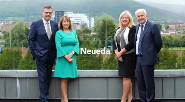 Brendan Monaghan of Neueda (far right) pictured in June with Invest NI head Alastair Hamilton, Ann McGregor, chief executive, Northern Ireland Chamber of Commerce and Industry, Michelle Bell, Department of the Economy