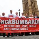 Labour MP Owen Smith (wearing glasses, third from right) with workers from Bombardier protesting outside the Houses of Parliament yesterday