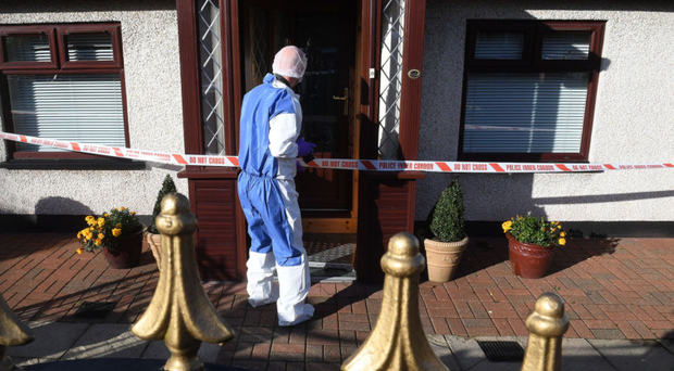 Police forensic experts examine Anne O'Neill's home in Finaghy yesterday