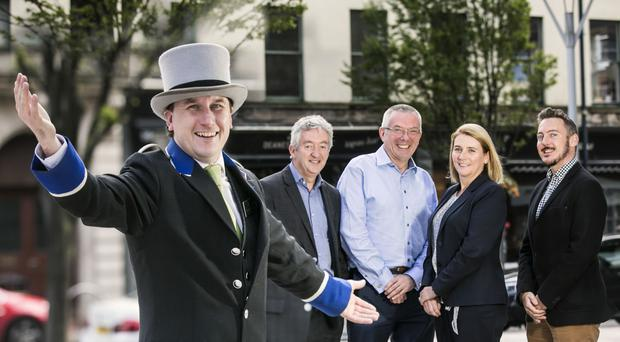 Europa concierge Jonathon Wade celebrates news with John McGrillen of Tourism NI; John Healy of Moloney Kelly, Caitriona Lavery of Hastings Hotels and Michael Dalton of Hosts Global