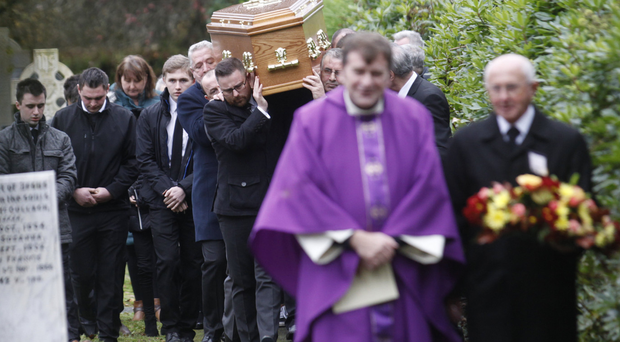 Friends and family carry the coffin of Nishi Ward in Plumbridge