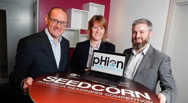 Seedcorn project manager Connor Sweeney with Helen McCarthy and Darrach Neeson from Phion Therapeutics