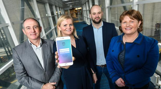 Nuala Murphy (second left), chief executive of technology company Moment Health, is joined (from left) by Prof Maurice Mulvenna, Dr Raymond Bond and Dr Anne Moorhead of Ulster University