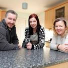 Glynis Hobson of Co-Ownership Housing (right) with Alan Gamble and Lesa Maginn, who have bought a home in Rathfriland through the organisation