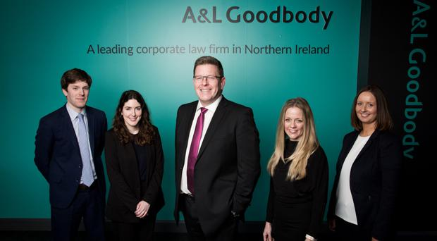 Mark Thompson (centre), head of office at A&L Goodbody, with four of the firm's 25 new hires in 2017. Left to right: solicitors Robert Tubman, Charlotte Turk and Barbara Creed, along with new HR lead Jill Michael