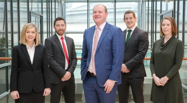 Richard Murphy (centre), of Pinsent Masons, with (from left) Anna Flanagan, associate for disputes, Ross Townsley, property associate, Matthew McMurray projects solicitor, and projects associate Laura Donnelly