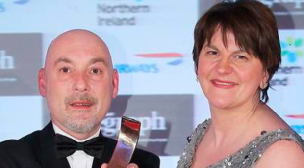 Crawford MacLean picking up Belfast Telegraph award from Arlene Foster