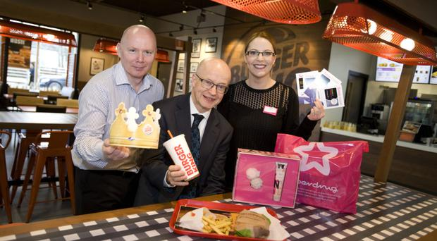 Burger King NI regional manager Robert Ferguson, Buttercrane centre manager Peter Murray and Roisin Mallon, Superdrug Newry manager