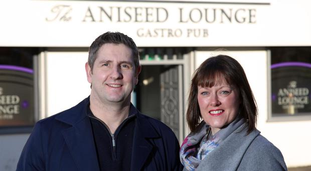 Nick and Joanne Clough outside their gastro pub in Ballynahinch, The Aniseed Lounge