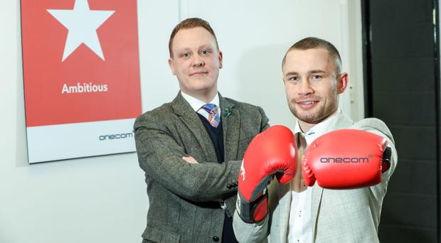 Boxer Carl Frampton (right) with Paul Lawther, head of Onecom in Northern Ireland