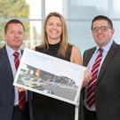 Richard Ward, sales director; Caroline Willis, finance director and Paul Ward, sales director with plans of the new Shelbourne Motors showroom