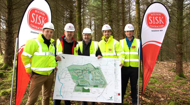 Stephen Bell, of Lagan/ Fasthouse, Alan Gammon, Jackson Design Associates, Kevin Lagan, from Lagan/Fasthouse, and Brian Kennedy and Cormac Fitzpatrick, from Sisk, view Center Parcs plans