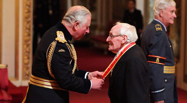 Sir William Wright receives his knighthood from the Prince of Wales