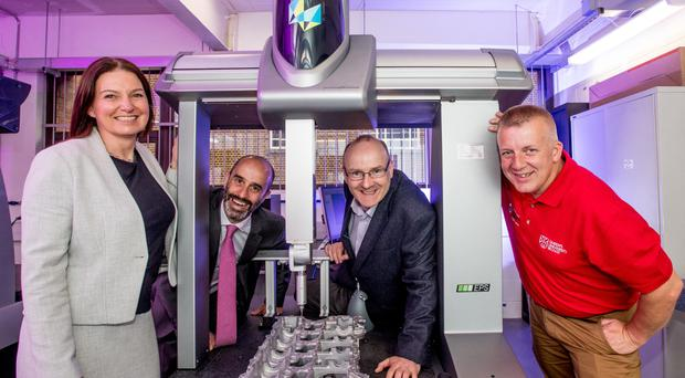At the manufacturing technology facility are (from left) Claire McAlinden, Prof Adrian Murphy, Prof Sean McLoone and Colm Higgins