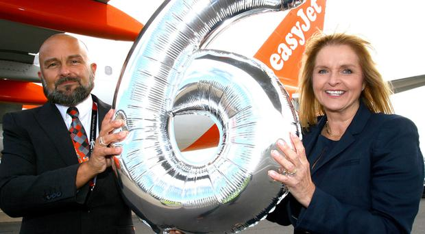 EasyJet's Jason Davis and Ali Gayward celebrate the arrival of its sixth aircraft at Belfast International
