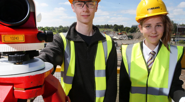 Patrick Robinson, Farrans placement student engineer, and Katie-Ann Fegan from Brownlow Integrated College in Craigavon at the site of the new leisure centre