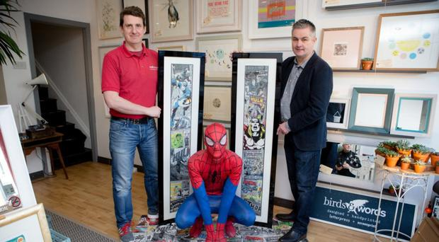 Ian Matchett (left) of Wallhangers in Belfast with the Marvel character Spider-Man and John Davidson of Woodstyle Flooring NI