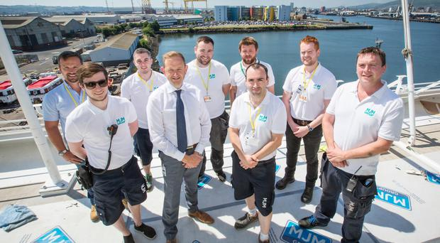 Some of the MJM Group team on board the Azamara Pursuit currently undergoing a major refit in Belfast. Front row (from left), Aodhan Grego, quantity surveyor; Gary Annett, CEO; Jonathan McGarry, QS manager; Stephen Ferris, assistant contracts manager. Back row (from left), Richard Wilk, contracts manager; Brendan Caraher, quantity surveyor; Alan O'Reilly, contracts manager; Philip Higgins, project planner; Patrick Doyle, assistant project planner