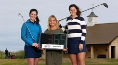 Tourism NI's Susie Brown (centre) with golfers Paula Grant (left) and Olivia Mehaffey at Royal Portrush starting the countdown to the 148th Open