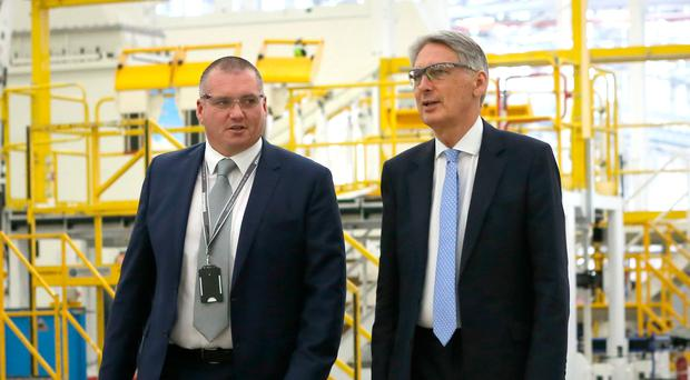 Chancellor of the Exchequer Phillip Hammond (right) with Jonathan Connell, vice president of operations at Bombardier during his visit to Belfast factory yesterday