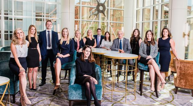 Carson McDowell's new associates and assistant solicitors at Grand Central Hotel with the firm's managing partner Michael Johnston (fourth from right)
