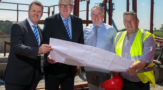Donnelly Group managing director Dave Sheeran, director Raymond Donnelly, Martin Nugent from McKeown and Shields, and Peter O'Neill who is director at O'Neill of Clonoe