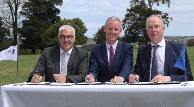 Richard Kennedy, Devenish chief executive, with Andrew McDowell, EIB vice president, and Owen Brennan, Devenish executive chairman