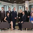 Pinsent Masons staff including front, from left: Nicola McKane, Seana Donaghy, Michael Hamill, Emma Swan. Back, fromleft: Niall McCavitt, Ben Semple, David McGuinness, Richard Masters, Lisa Early, Jonathan O'Hagan, John Hart and Ross Townsley