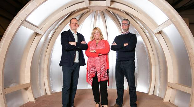 Intupod managing director Peter Farquharson (left) and commercial director David Maxwell (right) show Anna McDonnell, centre manager of the Innovation Factory the first aluminium glamping pod under construction in their factory