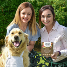 Claire McNally (left) and Laura Rafferty of Mackle Petfoods, with retriever Holly