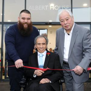 Albert (centre), James (left) and Spencer Pau officially open the all-new Asia Supermarket on Ormeau Embankment