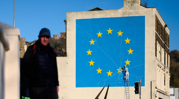 A painting depicting a workman chipping away at a star on the EU flag by artist Banksy in Dover, England, this month