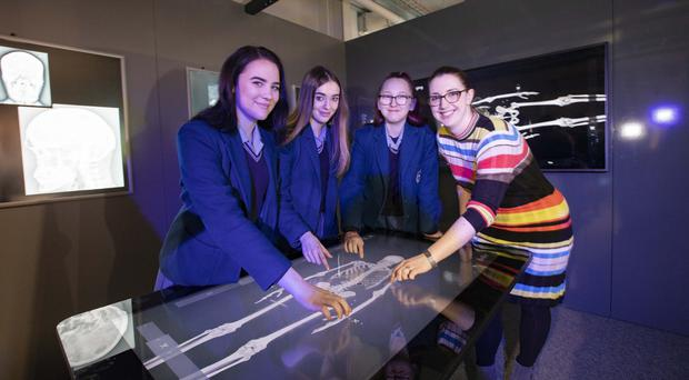 Former Ashfield Girls High School student Nicky Boyd, who now works at Almac Group, inspires its pupils Danielle Wiseman, Carly McMurray and Claire-Louise Glenfield at the new MED-Lab exhibition