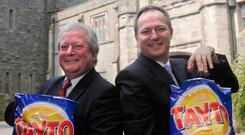 Tayto chairman Raymond Hutchinson and (right) Paul Allen, then chief executive of Tayto