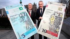 Richard Donnan and Terry Robb with outsized versions of the new notes