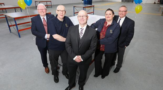 From left: Usel chairman James Perry, employee Martin O'Connor, chief executive Bill Atkinson, staff member Jane McGrath and Greg McKinley, Gallaher Trust director of operations