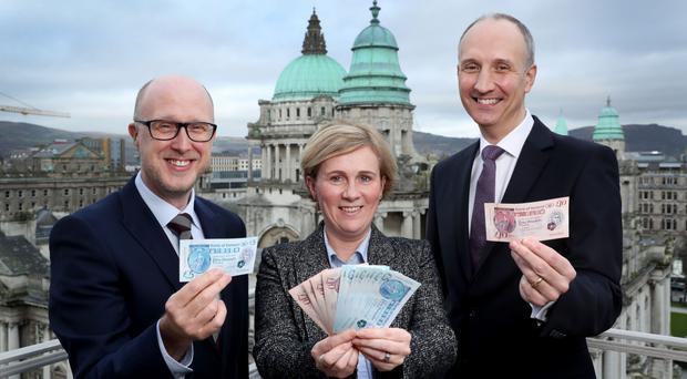 Bank of Ireland's Thomas McAreavey, Judith Hearty and Ian Sheppard with the lender's new polymer banknotes, which entered circulation last month