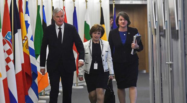 Diane Dodds and Arlene Foster with Michel Barnier last year