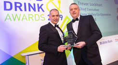 Nigel Walsh (left) of Ulster Bank presents Fane Valley chief executive Trevor Lockhart with his award for outstanding contribution to the industry