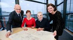 Lydia McClelland (in red), head of W5, and Robert Fitzpatrick (also seated) of the Odyssey Trust discuss the plans with Bruce Davies of Aivaf and Sarah Clarke of Mather & Co